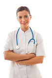 Woman doctor with arms crossed standing over white background Stock Image