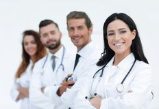 Woman doctor on the background of colleagues. Closeup.woman doctor on the background of colleagues Stock Images