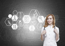 Woman doctor and blackboard with hexagonal medicine sketches Royalty Free Stock Image