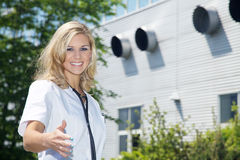 Woman doctor with a building Royalty Free Stock Images