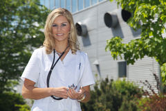 Woman doctor with a building Royalty Free Stock Image