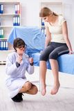 The woman doctor checking with sensory hammer. Woman doctor checking with sensory hammer Stock Images