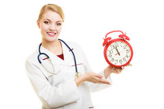 Woman doctor with clock isolated on white Stock Photography