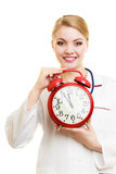 Woman doctor with clock isolated on white Stock Photo