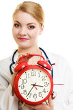 Woman doctor with clock isolated on white Royalty Free Stock Images