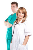 Woman doctor with a colleague Royalty Free Stock Photos