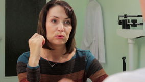 Woman at the doctor stock footage