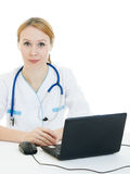 A woman doctor consultant with a laptop Royalty Free Stock Photography