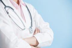 Woman doctor cross her arm Stock Photos