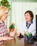 Woman and  doctor discussing medical issues Stock Photography
