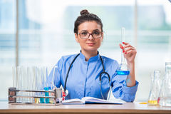 The woman doctor doing chemical tests in laboratory Stock Photo