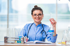 The woman doctor doing chemical tests in laboratory Stock Photography