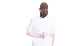 Woman doctor doing thumb up gesture on her back Royalty Free Stock Images