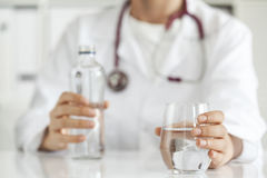 Woman doctor with drinking water. Woman doctor with  drinking water Royalty Free Stock Photos