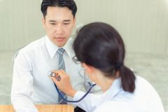 Woman doctor examinating patient by stethoscope, Healthcare and stock photography
