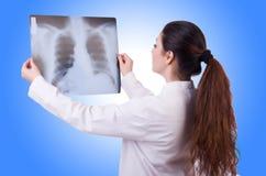 Woman doctor examining x-ray Stock Photo