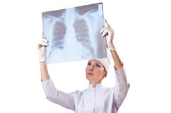 Woman doctor examining x-ray Stock Images