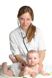 Woman doctor exams baby Royalty Free Stock Photo