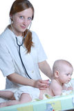 Woman doctor exams baby Stock Photography