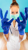 Woman doctor in face mask and gloves Royalty Free Stock Photo
