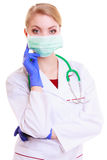 Woman doctor in face mask with stethoscope. Woman in face mask and white lab coat. Doctor or nurse with stethoscope isolated. Medical person for health insurance Stock Photos