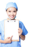 Woman doctor finger pointing blank clipboard. Young woman doctor or nurse finger pointing empty blank clipboard sign with copy space for text isolated over white Royalty Free Stock Images