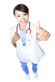 Woman doctor giving thumbs up Stock Photo