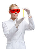 Woman doctor in glasses hands vial Stock Image