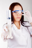 Woman doctor in glasses with a syringe Royalty Free Stock Images