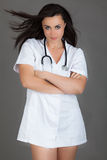 Woman doctor on grey background medical staff personell nurse Stock Image