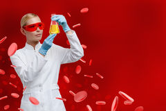 Woman doctor hands Erlenmeyer flask stock photography