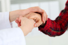Woman doctor hands holding female child patient hand Stock Photo