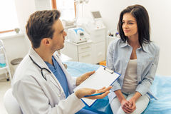 Woman at the doctor Stock Photo
