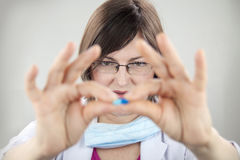 Woman doctor holding blue capsule Stock Photos