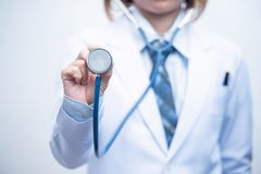 Woman doctor holding blue stethoscope royalty free stock images