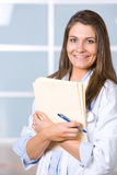 Woman doctor holding a chart Royalty Free Stock Photos