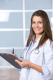 Woman doctor holding a chart Royalty Free Stock Photo
