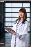 Woman doctor holding a chart Stock Image