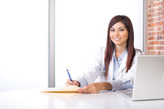 Woman doctor holding a chart Royalty Free Stock Images