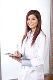 Woman doctor holding a chart Stock Photo