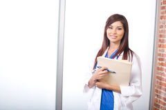 Woman doctor holding a chart royalty free stock image