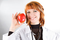 woman doctor holding red apple Royalty Free Stock Image