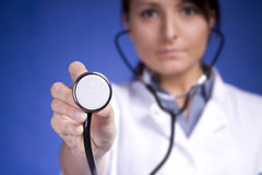 Woman doctor holding stethoscope. Nurse Stock Images