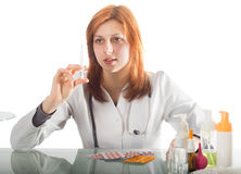 Woman doctor holding a syringe Stock Image