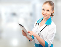 Woman Doctor holding a tablet computer Royalty Free Stock Images