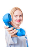 Woman doctor holding a telephone Stock Images