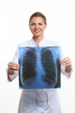Woman doctor holding an x-ray edges Royalty Free Stock Photography