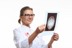 Woman doctor holding an x-ray of the head Stock Image