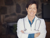 Woman doctor at home Stock Photography