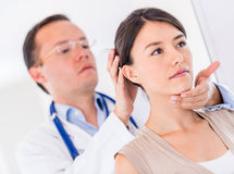 Woman at the doctor Stock Photos